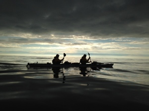 Nick & Adam paddling on an oil-like sea just before sunset. Photo by Tori James